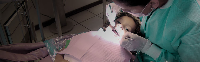 volunteer helping in dental checkup