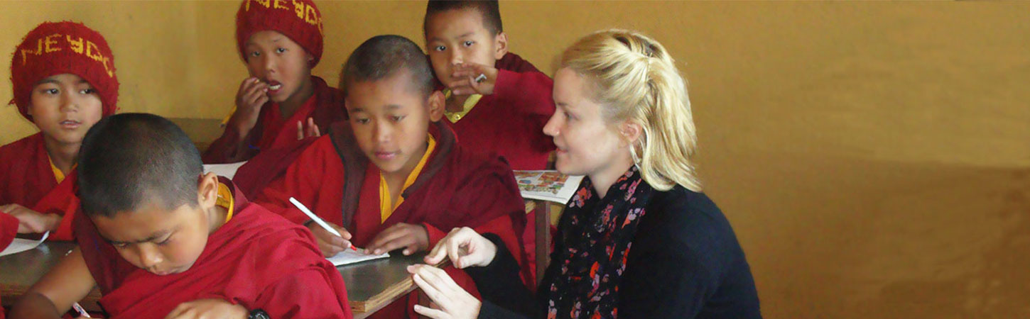 Our Volunteer teaching young monks